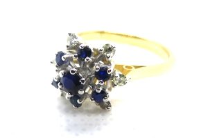 vintage sapphire and diamond cluster cocktail ring