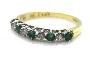 emerald and diamond half hoop ring